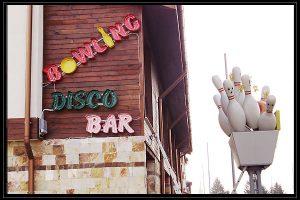 bowling disco bar glowing ads
