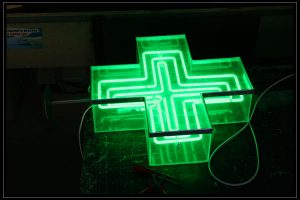 green cross glowing ads