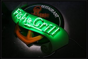 fish and grill glowing ads